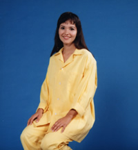 Lady wearing a two pieces yellow pijamas