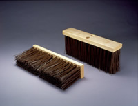 Two outdoor push brooms
